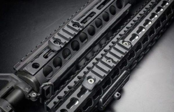 M-LOK (left) and KeyMod (right) side-by-side