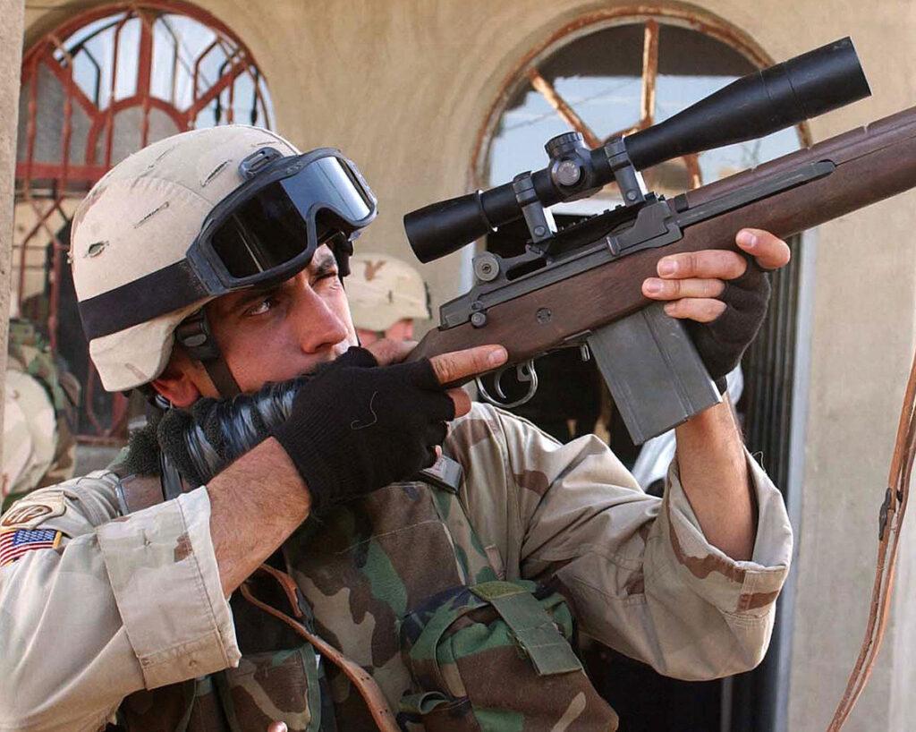 A sniper in Al Fallujah, Iraq with anM14 with a Leupold Mark 4 LR/T 10 x 40 mm M3
